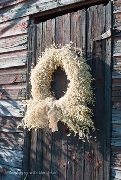 Wheat. How cool on a farmhouse door. Or even on a bright colored door with the same color ribbon.