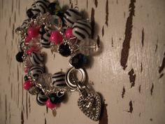 $15.00 Zebra Fun Zebra Beads With Pink, Black And Clear  Beads  Very Fun Bracelet For someone Who Love Zebra Print  For more Wonderful Jewelry Come Check Out My Page www.facebook.com/daniellesbeads  Thank You For Looking Have A Great Day!!!