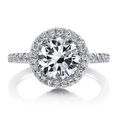 MARIE ANTOINETTE is a handcrafted Jean Dousset Diamonds engagement ring with a diamond seamless halo™ and 1 row of diamonds on the band - JeanDousset.com - shown in Platinum with a Round Brilliant cut diamond and 6 rose cut diamonds underneath the center stone. #Round Cut #Diamond #RoundDiamond #EngagementRing
