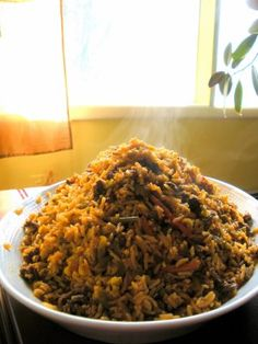 Rice with Green Beans (Loobia Polow) This dish is a delicious combination of rice, meat, green beans and tomato sauce.