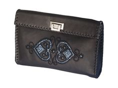 Pearls and sequins hand embroidered leather bag by Pascale Théard