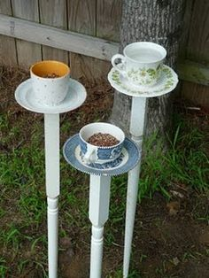 Tea Cup Bird Feeders. I had one of these in my last garden. I need to find a better way to glue them together. I big jay kept knocking it over.