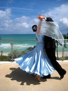 Ballroom dancing by the beach, maybe a cute honeymoon photo idea.