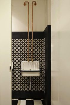 Alape Bucket Sink – A humble bucket sink in the Old Library Restaurant washroom, designed by Australian firm Hecker Guthrie, is elevated by the addition of exposed copper piping and a painted wall mimicking tiles.