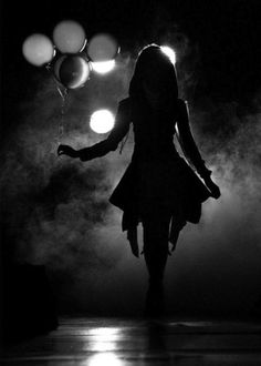 I love the #dark #moodiness paired with the #balloons. It makes you wonder where she's going and what she's celebrating.