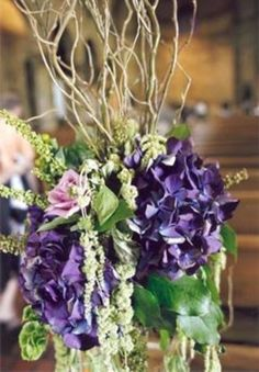 Purple Hydrangea and Curly Willow in Altar Arrangement/ Centerpiece. Wedding Flowers by Lexington Floral in Shoreview, MN.