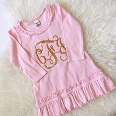A darling light pink, ruffle dress with a beautifully embroidered mustard monogram! Perfect for the holidays, especially Thanksgiving! This cute dress is wonderful as a dress or as a tunic paired with