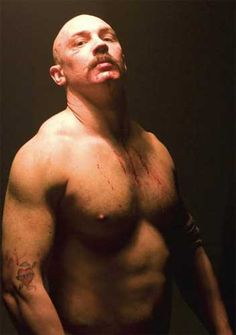 Tom Hardy in Bronson.   Great movie, bit weird.  Google Image Result for http://filmjamblog.files.wordpress.com/2012/06/bronson1.jpg