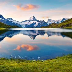 Grindelwald Grindelwald, Switzerland mountain sky grass Nature wilderness tarn mount scenery mountainous landforms Lake nature reserve highland water glacial lake mountain range bank fell leaf fjord morning national park green loch hill landscape cloud water resources alps reservoir overlooking watercourse crater lake tundra computer wallpaper meadow lake district hillside tree elevation autumn lush beautiful land surrounded