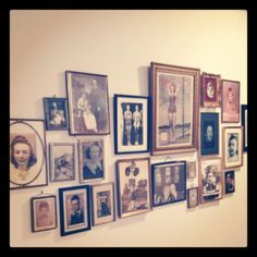 Old timey photo wall with hodge podge picture frames. All started with Grandma's large pinup pic and then I started picking up random picture frames at the flea market and the wall grew...every time I come home it puts a smile on my face. Nothing like seeing the pictures of those that have left a legacy for your children to be surrounded by!!