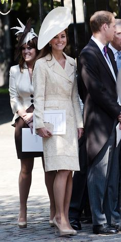 July 30, 2011 Catherine attended the wedding of Zara Phillips and Mike Tindall in Scotland in an ivory brocade coat by Jane Troughton buttoned up over a lace dress. This is the same combo she wore for the wedding of Harry Lopes and Laura Parker Bowles, daughter of Duchess of Cornwall Camilla Bowles, in 2006. However, she made one addition: an asymmetrical white hat.