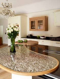 Island with beautiful contrasting curves - http://www.davonport.com/kitchens/canterbury
