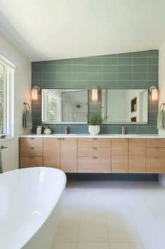 The understated green tones and the clean lines in this beautiful bathroom are key elements of the Mid-Century Modern Style. Mid Century Modern Bathroom, Modern Master Bathroom, Modern Bathroom Design, Mid Century Modern Design, Bathroom Interior Design, Modern House Design, Mid Century Bathroom Vanity, Master Bathrooms, Bathroom Designs