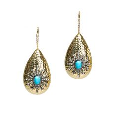The Murphy Earrings will frame your face and enhance your look. Comprised of a hammered polished gold drop, these earrings are enhanced with a starburst of dark rhinestones with a turquoise center. Put these on with skinny jeans, a soft tee and heels and you'll be ready for the party.  Find it on Splendor Designs