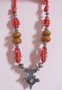 Berber Silver Enamel CrossSilver Red Resin and by TuaregJewelry, $178.00 Berber Silver Enamel Cross,Silver, Red, Amber Color Resin and Coral Color Beads, Morrocan Sahara  Total Length necklace: 54.5 cm with clasp  Cross Pendant, Silver & Enamel: L 5.5 cm x W 4.5 cm