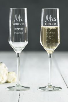Set of 2 Mr and Mrs flute glasses make a lovely wedding or anniversary gift. Mr & Mrs is fixed text, personalise by choosing the name and date to be engraved onto the glasses. Hand wash only. Bridesmaid Glasses, Wedding Wine Glasses, Wedding Champagne Flutes, Engraved Champagne Flutes, Toasting Flutes, Flute Glasses, Cricut Wedding, Personalized Wedding, Wedding Gifts