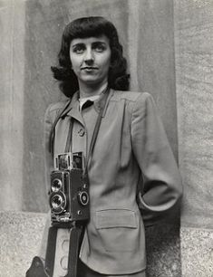 Esther Bubley –   OWI (Office of War ) photographer. - I'm going to be writing a research paper on this lady for my photography class :)