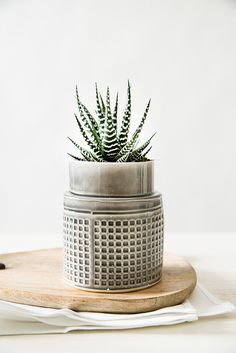 Modern geometric planter, ceramic flower pot, made of light gray glazed ceramic with a delicate square geometric pattern. This light shiny gray ceramic vase is perfect for presenting your garden flowers or fresh picked herbs in your kitchen. A great Succulent planter / Air Plant Pot for your studio or office stationery. Each piece is made by hand, using folded stoneware sheets stamped with a square geometric pattern. Dipped in light gray shiny glaze, burned to high temperature. >6.5...