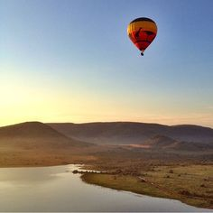 Who is joining for a hot air balloon ride over the Pilansberg National Park? Photo by @smmerly #ThisIsSouthAfrica