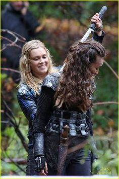 Eliza Taylor and Alycia Debnam-Carey get in a laugh or two while filming new scenes for The 100 in Vancouver, Canada on Tuesday afternoon (October 28). Description from justjaredjr.com. I searched for this on bing.com/images