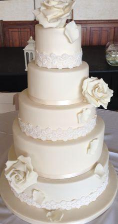 Ivory roses and lace wedding cake
