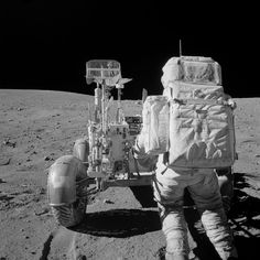 April — Astronaut John W. Young, commander of the Apollo 16 lunar landing mission, reaches for tools in the Apollo Lunar Hand Tool Carrier at the aft end of the Lunar Roving Vehicle (LRV) during the second Apollo 16 extravehicular activity.