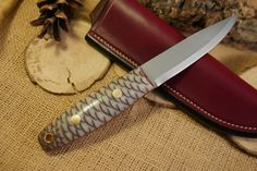 Adventure Sworn Custom Bushcraft Knife - Woodsman model - Pine Cone in White Cast - Customize your own knife #custom #knife #survival #camping #hiking #bushcraft #backpacking #hunting #outdoors #fishing #edc