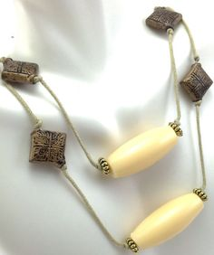 I'm auctioning 'Vintage Celluloid Cream Bead Cord Necklace String Long Jewelry' on #tophatter