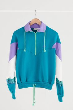 Shop Vintage Nike Teal + Lavender Colorblocked Half-Zip Sweatshirt at Urban Outfitters today. We carry all the latest styles, colors and brands for you to choose from right here.