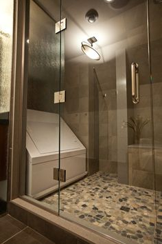 Example of a flotation room with tank. Glazed Autumn Mosaic stone tile floors hide salt well.