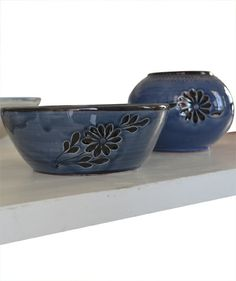 I simply admire the handmade beauty of this set of Bowl & Vase, on a white background.   First wheelthrown then engraved w/ traditional flowers design.  Painted on top w/ a beautiful indigo color.