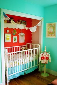 Nursery in a small space? take the doors off the closet and tuck the crib in. Love these retro color.