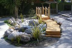 Bridge with dry river at Kindergarten. A small area renovated to add interest to the playground.