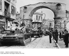 GREECE: GERMAN TANKS, 1944.   German tanks driving through the Galerius Arch in Salonika, Greece, during World War II. German army photograph, April 1944. Full credit: SV-Bilderdienst - ullstein bild / The Granger Collection.  Credit: ullstein bild / The Granger Collection, NYC — All rights reserved.