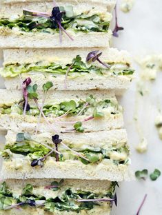 Tramezzini with salad and remoulade -   Between two slices of toast are spicy remoulade, salad and radish.