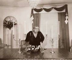Carole in the dining room of her Hollywood Boulevard home 1934