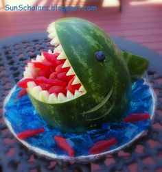 Party shark made from watermelon. So awesome AND a healthy snack! - At least in my version it would be. Thinking of using cookie cutters to make fish from water melon slices.