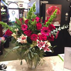 It's been a week of romance. How stunning is this arrangement that went out. #florist #flowers #flowershop #princetagram #nj #princeton #redroses #rose