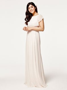 An elegant floaty cream dress from the Maids to Measure collection which has been beautifully designed with a delicate cap sleeves, a soft boat neckline and has a stunning v-shaped back. Product name: Isla (Floaty) in Cream Soda.  View more Bridesmaid dresses from our Maids to Measure collection at: http://www.baroqueboutique.co.uk/bridesmaids/  Photographs courtesy of: http://www.maidstomeasure.com/