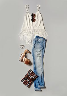 A little fringe, destroyed skinnies, wedges, woven clutch and of course a great pair of sunnies -- great combo for a relaxed bohemian look.