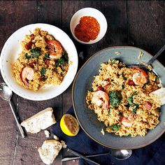 Creole rice with shrimp, sausage, and kale recipe.   2 Tbsp. vegetable oil, divided 2 tsp. Cajun Seasoning, divided 1 lb. uncooked medium shrimp, peeled and deveined 4 ounces kielbasa, cut in 1/4-inch pieces 1 small yellow onion, finely chopped 1 clove garlic, finely chopped 1 bunch kale, coarse stems removed and chopped 1/4 cup water 1 package Knorr® Menu Flavors Rice Sides™ - Creole Garlic Butter, prepared according to package directions