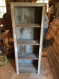 Corrugated metal and barn wood book shelf
