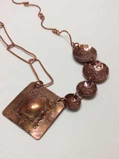 A personal favorite from my Etsy shop https://www.etsy.com/listing/232461380/copper-mandala-hand-stamped-chain