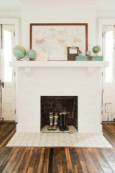 Fireplace mantle..i think i will paint mine white!!!! lovin the floors too...
