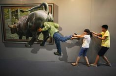 Kids pose for a photograph in front of a 3D painting at 2012 Magic Art Special Exhibition in Hangzhou