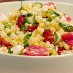 Looking for a fresh side dish this summer? Look no further with this fresh corn and tomato salad, tossed with creamy mozzarella pearls, basil and a tangy dressing. Brought to you from our Food Network Kitchen.