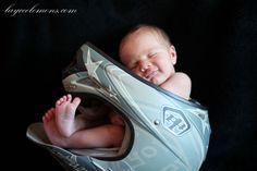 Newborn in dirtbike helmet.