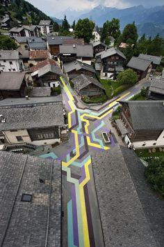 Geometric street painting through Switzerland village.