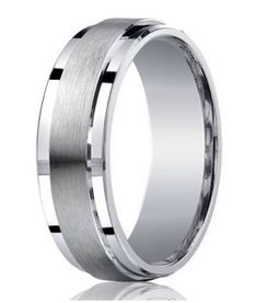 Designer rings like this 7mm Mens Silver Wedding Ring are one-of-a-kind, which may explain why it's a perennial best seller. Here, the designer takes an otherwise conservative look and makes it thoroughly modern. It features a raised satin band that is flanked by polished step-down edges on each side, and a flat profile that gives it a very contemporary feel. $149.95
