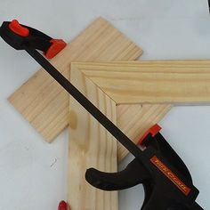 Simple picture frame clamp holderAll you need is a carpenter's square or steel corner to use as a guide for cutting perfect 45-degree cut outs.